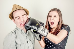 Woman from sales punching man from marketing