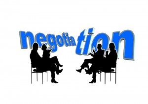 businesspeople in negotiation – 10 Top Tips to Be a Better Negotiator