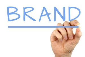 Hand writing 'Brand' – 6 tips for creating a strong brand